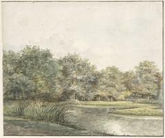 Landschap met bomen aan het water