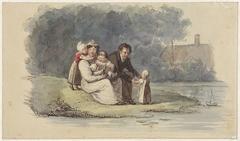 Familie zittend aan het water